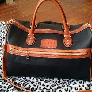 Gucci black with tan scraped duffle bag